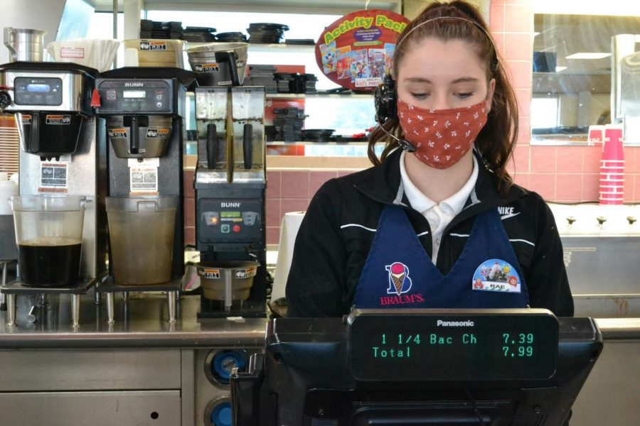 Student Kathryn Pardue operating a cash register at Braum's in north Springfield.